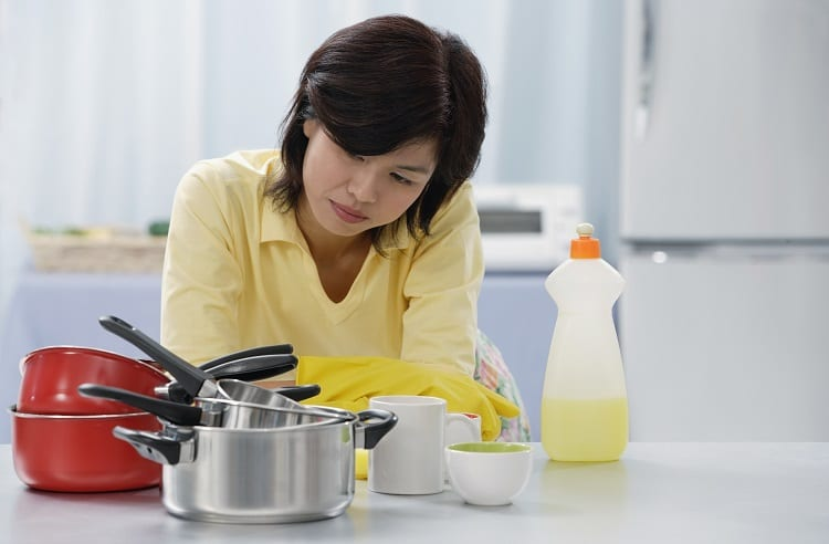 Woman Preparing To Wash Cookware